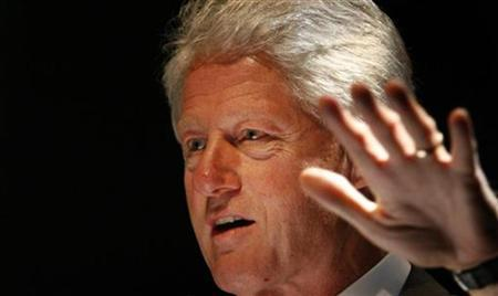 Former U.S. President Bill Clinton speaks during a lecture in Hamburg October 7, 2007. REUTERS/Christian Charisius