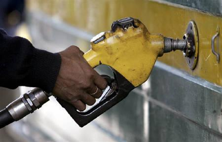 A worker fills a car at a petrol pump in Siliguri in this February 16, 2007 file photo. OPEC is likely to discuss creating a basket of currencies for oil pricing at its next summit due to the steady decline in the dollar, Venezuela's Energy Minister Rafael Ramirez said on Friday. REUTERS/Rupak De Chowdhuri