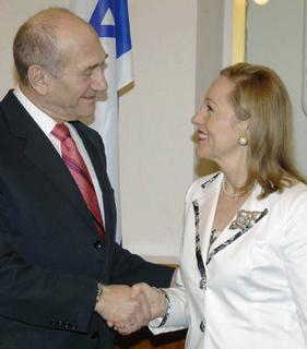 Israel's Prime Minister Ehud Olmert (L) shakes hands with European Union External Relations Commissioner Benita Ferrero-Waldner during their meeting in Jerusalem October 29, 2007, in this picture released by the Israeli Government Press Office (GPO). REUTERS/Moshe Milner/GPO/Handout