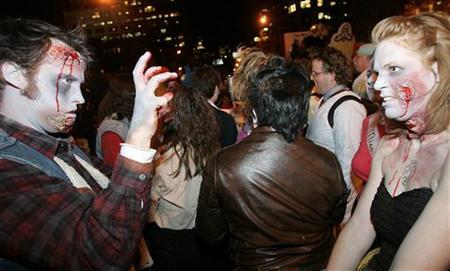 Members of the Zombie Army dance to Michael Jackson's ''Thriller'' at the 32nd Annual Village Halloween Parade in New York October 31, 2005. Passengers on a German train mistook a Halloween reveler dressed up as a gore-covered zombie for a murder victim and called the police. REUTERS/Seth Wenig