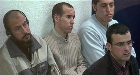Rabei Osman Sayed Ahmed ''Mohamed the Egyptian'' (L), Abdelilah El Fadual (2nd L), Rachid Aglif and Mohamed Bouharrat (front R), some of the accused in the 2004 Madrid train bombings, sit in court in this video frame grab taken inside an annex of the High Court in Madrid March 12, 2007. Ahmed lost an appeal in Italy on Monday against a separate terrorism conviction, his lawyer said. REUTERS/Pool