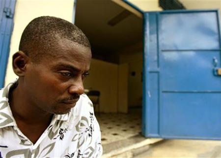 A man infected with the AIDS virus rests outside a clinic in Port-au-Prince in a February 2006 photo. The AIDS virus invaded the United States in about 1969 from Haiti, carried most likely by a single infected immigrant who set the stage for it to sweep the world in a tragic epidemic, scientists said on Monday. REUTERS/Daniel Aguilar