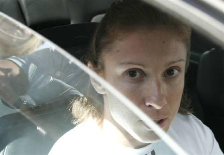 File photo of sprinter Katerina Thanou leaving the KAT hospital in Athens, August 17, 2004. Greek sprinters Thanou and Costas Kenteris and their former coach Christos Tzekos had no links with the BALCO laboratory at the centre of U.S. sport's biggest doping scandal, their lawyers said on Tuesday. REUTERS/Yves Herman/Files