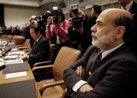 U.S. Federal Reserve Chairman Ben Bernanke sits before the start of the International Monetary and Financial Committee (IMFC) meeting at the IMF headquarters in Washington October 20, 2007. REUTERS/Yuri Gripas
