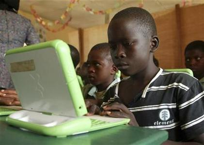 Nigerian pupils work on computers at the LEA primary school in Abuja in this May 30, 2007. The school is a pilot site for the ''One laptop per child'' project. The computer developed for the world's poor children, dubbed ''the $100 laptop'', has reached a milestone: It is now selling for $200. REUTERS/Afolabi Sotunde