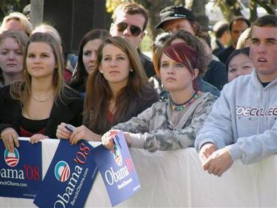 Young voters listen to U.S. Senator Barack Obama (D-IL) at a rally in Cedar Rapids, Iowa, October 29, 2007. Young voters have historically taken part in U.S. elections at a much lower rate than the public as a whole, but the last two national elections have seen a substantial increase in participation. REUTERS/Andy Sullivan