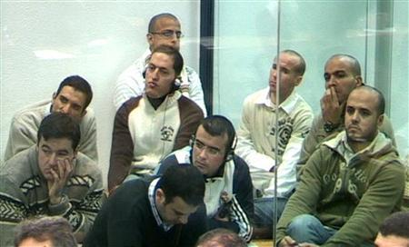 Some of the 28 suspects accused of the 2004 Madrid train bombings are seen sitting in court in this video frame grab taken inside an annex of High Court in Madrid, October 31, 2007. REUTERS/Pool