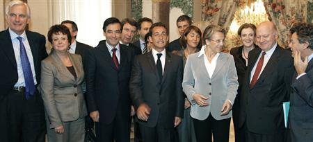France's President Nicolas Sarkozy (C) stands with members of his government including Prime Minister Francois Fillon as they pose following the weekly cabinet meeting held exceptionally on the French Mediterranean island of Corsica at the Prefecture building in Ajaccio, October 31, 2007. From left to right are, Michel Barnier, Minister for Agriculture and Fisheries, Housing Minister Christine Boutin, Prime Minister Francois Fillon, Education Minister Xavier Darcos, France's President Nicolas Sarkozy, Culture Minister Christine Albanel, Interior Minister Michele Alliot-Marie, Junior Minister for Ecology Nathalie Kosciusko-Morizet, Junior Minister for Budget Andre Santini, Environment Minister Jean-Louis Borloo. REUTERS/Ludovic/Pool