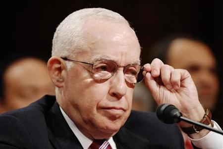 Michael Mukasey, nominee for Attorney General, adjusts his glasses during a confirmation hearing of the Senate Judiciary Committee on Capitol Hill in Washington, October 17, 2007. A top Democratic lawmaker announced his opposition on Wednesday to Mukasey, amid nagging concerns about the retired federal judge's view of torture. REUTERS/Jonathan Ernst