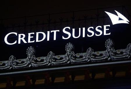 The Credit Suisse logo is seen on top of the bank's headquarters at the Paradeplatz in Zurich, January 16, 2006. Credit Suisse said third-quarter profit at its investment bank was all but wiped out by writedowns, leading to a 31 percent fall in group net earnings to 1.3 billion Swiss francs ($1.12 billion). REUTERS/Siggi Bucher