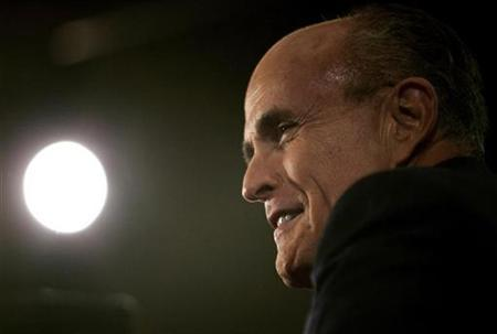 Republican presidential candidate and former New York City mayor Rudy Giuliani takes part in an interview following the Republican Party of Florida and Fox News Channel debate in Orlando, October 21, 2007. Britain's health secretary complained on Thursday about an advertisement run by Giuliani, saying the Republican presidential candidate had maligned Britain's health care system with bad statistics. REUTERS/Carlos Barria