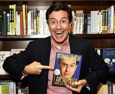 Entertainer Stephen Colbert poses with his new book ''I Am America (And So Can You!)'' at a book signing in New York October 24, 2007. Colbert's requests to be on the South Carolina Democratic and Republican primary ballots were rejected on Thursday. REUTERS/Lucas Jackson