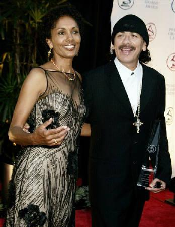 Musician Carlos Santana and wife Deborah are seen at the Latin Grammy Person of the Year dinner in Los Angeles in this August 30, 2004 file photo.  REUTERS/Fred Prouser