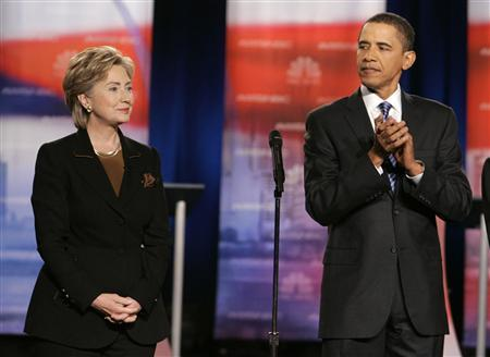Democratic presidential candidate Senator Barack Obama (D-IL) (R) looks over at rival Senator Hillary Clinton (D-NY) as they stand onstage together before the start of a debate at Drexel University in Philadelphia, October 30, 2007. REUTERS/Larry Downing