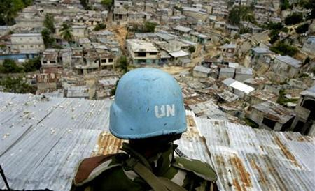 A U.N. peacekeeper from Sri Lanka patrols the neighborhood of Grand Ravine in Port-au-Prince September 6 2006. More than 100 Sri Lankan peacekeepers have been accused of sexual exploitation and abuse in Haiti and will be sent home on Saturday, the United Nations said, in the latest sexual abuse scandal involving U.N. peacekeeping missions. REUTERS/Stringer