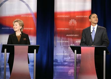 Democratic presidential candidates Senator Hillary Clinton (D-NY) (L) and Senator Barack Obama (D-IL) take part in a political debate at Drexel University in Philadelphia, Pennsylvania, October 30, 2007. REUTERS/Larry Downing