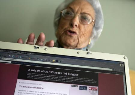 Web-blogger Maria Amelia Lopez shows the home page of her blog on a laptop screen in Sanxenxo October 5, 2007. REUTERS/Miguel Vidal