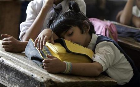 A hearing impaired Kashmiri girl sleeps in a classroom in Srinagar August 27, 2007. Insufficient sleep can negatively affect preteens' metabolism as well as their exercise and eating habits, researchers reported on Monday. REUTERS/Danish Ismail