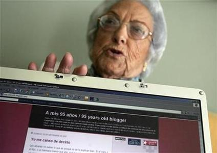 Web-blogger Maria Amelia Lopez shows the home page of her blog on a laptop screen in Sanxenxo October 5, 2007. At the age of 95 Lopez has surprised herself by a sudden conversion from Web-illiterate to cybercelebrity. REUTERS/Miguel Vidal
