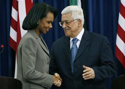 Secretary of State Condoleezza Rice (L) and Palestinian President Mahmoud Abbas shake hands after their joint news conference in the West Bank city of Ramallah November 5, 2007. Rice took her diplomatic mission to the occupied West Bank on Monday for talks with Palestinian leaders seeking deadlines for future statehood negotiations with Israel. REUTERS/Loay Abu Haykel