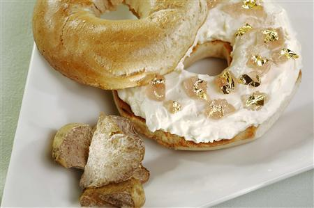 A New York chef has created what is believed to be the first $1,000 bagel, adding white truffle cream cheese and goji berry infused Riesling jelly with golden leaves on top of the city's staple, as shown in this photograph taken by the hotel The Westin New York at Times Square in Manhattan this month. The bagel is the creation of chef Frank Tujague of The Westin New York hotel and was designed in part to help raise funds for Les Amis d'Escoffier Scholarship, which provides scholarships to students of the culinary arts. REUTERS/Westin New York/Handout. EDITORIAL USE ONLY. NOT FOR SALE FOR MARKETING OR ADVERTISING CAMPAIGNS. NO ARCHIVES. NO SALES.