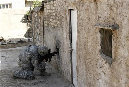 A U.S. army soldier with Bravo Company 1st battalion 64th Armor Regiment inspects a house during a patrol in the neighborhood of Jamia in Baghdad November 6, 2007. REUTERS/Stefano Rellandini