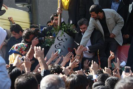 Iranian President Mahmoud Ahmadinejad shakes hands with supporters as he attends the funeral ceremony of recently recovered bodies of fallen soldiers of the Iran-Iraq war (1980-1988), in Tehran, November 6, 2007. The ceremony was held to commemorate the deaths of the unidentified soldiers. REUTERS/Raheb Homavandi