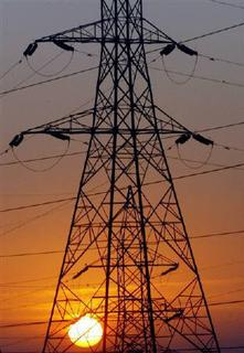 The sun rises behind electric pylons in Ahmedabad, in this February 21, 2006 file photo. India's primary energy demand will more than double by 2030, growing an average 3.6 percent every year, due to a strong economic growth. REUTERS/Amit Dave