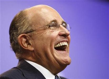 Republican presidential candidate Rudy Giuliani laughs at the Institute of Politics at Saint Anselm College in Manchester, New Hampshire November 5, 2007. REUTERS/Brian Snyder