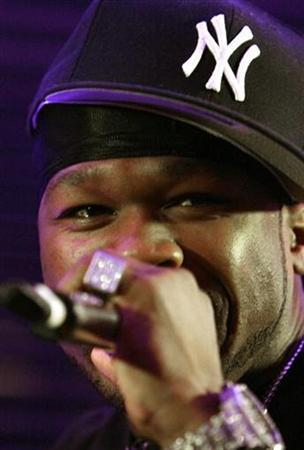 Rap star 50 Cent performs during a party on the eve of the World Music Awards in Monte Carlo November 3, 2007. The awards will take place in Monaco November 4. Researchers at the University of Pittsburgh School of Medicine, who studied the lyrics of hundreds of popular songs such as 50 Cent's ''Disco Inferno,'' found that one in three mention alcohol or drug use. REUTERS/Eric Gaillard