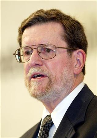 Federal Reserve Bank of St Louis President William Poole speaks at a Bank of Korea seminar in Seoul June 16, 2006. St. Louis Federal Reserve President William Poole on Wednesday said further interest rate cuts might be needed if problems in the housing market spread further, but said the Fed needs to be wary not to overshoot and risk stoking inflation. REUTERS/You Sung-ho