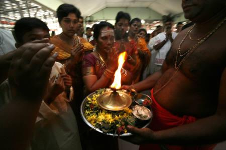 Malaysian Hindu devotees recite prayers during Diwali celebrations at a temple in Kuala Lumpur November 8, 2007. REUTERS/Bazuki Muhammad