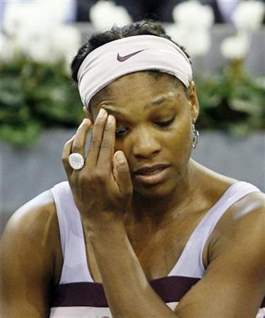 Serena Williams of the U.S. gestures shortly before retiring from her tennis match against Anna Chakvetadze of Russia because of an injury at the WTA Championships in Madrid, November 7, 2007. REUTERS/Andrea Comas