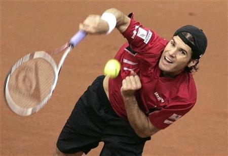 Germany's Tommy Haas serves to Russia's Igor Andreev during their Davis Cup semi-final tennis match in Moscow, September 21, 2007. REUTERS/Sergei Karpukhin