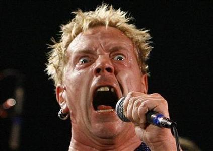 Lead singer Johnny Rotten performs with Sex Pistols at the Roxy bar in Los Angeles October 25, 2007. The Sex Pistols launch their brief reunion tour with a gig at Brixton Academy in London on Thursday. REUTERS/Mario Anzuoni
