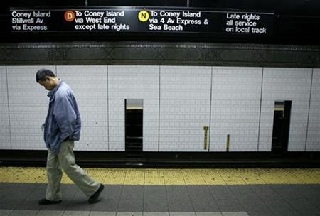 A man walks alone in the subway while waiting to catch a train towards Coney Island, New York in this file photo from April 1, 2007. REUTERS/Lucas Jackson