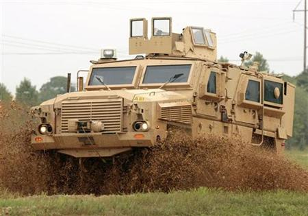 A Mine Resistant Ambush Protected (MRAP) Classification One vehicle demonstrates its off-road abilities in a water puddle at the U.S. Army's Aberdeen Proving Grounds in Aberdeen, Maryland, August 24, 2007. Monthly production of new armored vehicles designed to protect U.S. troops from roadside bombs should reach over 1,000 by year's end, and more than 1,500 should have arrived in Iraq, Pentagon officials told lawmakers on Thursday. REUTERS/Larry Downing