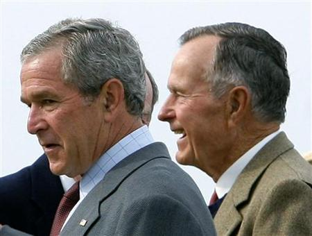 President Bush and his father former President George Herbert Walker Bush leave a church service at St. Ann's Episcopal church in Kennebunkport, August 27, 2006. Critics of President George W. Bush's handling of the Iraq war are ''grossly unfair'' and have forgotten the brutality of deposed Iraqi leader Saddam Hussein, Bush's father said in an interview published on Friday. REUTERS/Jim Young