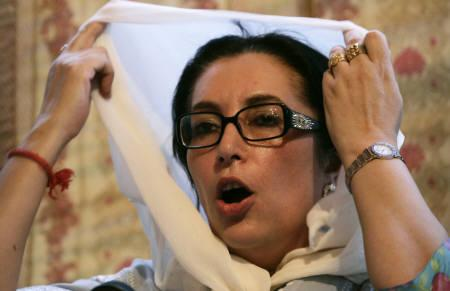 Former Pakistani Prime Minister Benazir Bhutto adjusts her scarf during a news conference in Islamabad November 8, 2007. Bhutto returned to her residence in Islamabad after police blocked her way after she tried leaving to attend a rally against President Pervez Musharraf on Friday. REUTERS/Faisal Mahmood
