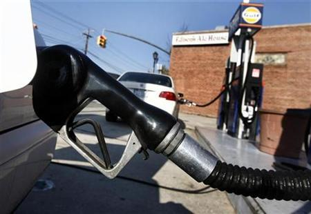 A car is filled with gas at a Gulf station in Manhasset, New York October 30, 2007. A German man forgot his car after filling it up at a petrol station, police said Friday. REUTERS/Shannon Stapleton