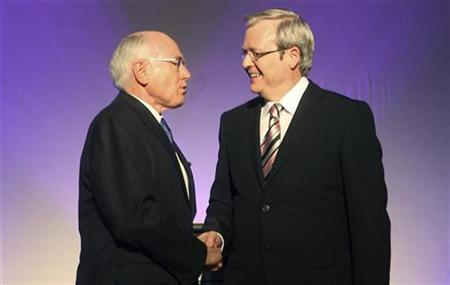 Australia's Prime Minister John Howard (L) shakes hands with opposition leader Labor's Kevin Rudd (R) prior to a live televised debate at Parliament House in Canberra October 21, 2007. More Australian voters would like to see Rudd naked than Howard, a poll showed on Sunday. REUTERS/Andrew Taylor/Pool