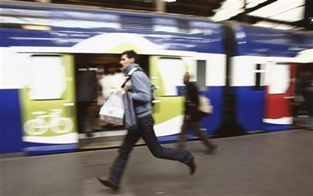 A commuter runs for a train at the Paris Gare Saint Lazare railway station, October 18, 2007. French commuters dusted off old bikes and aired their walking shoes on Tuesday in anticipation of a transport strike that is set to last for days and could become the biggest the country has seen in more than 10 years. REUTERS/Regis Duvignau