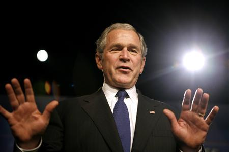 President George W. Bush gestures to the audience after being introduced to speak about the budget during a trip to New Albany, Indiana November 13, 2007. REUTERS/Kevin Lamarque
