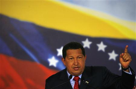 Venezuela's President Hugo Chavez attends a news conference with foreign correspondents at Miraflores Palace in Caracas November 13, 2007. REUTERS/Jorge Silva