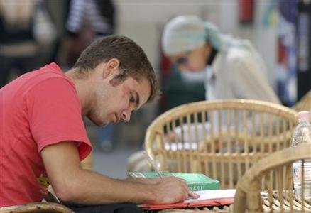 A student studies on one of the campuses at the American University in Cairo, October 24 2007. REUTERS/Tara Todras-Whitehill