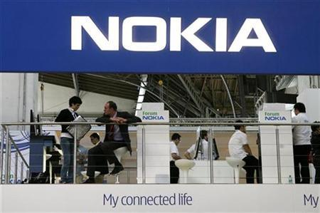People visit Nokia's stand during the 3GSM World Congress in Barcelona, February 15, 2007. The world's top cellphone maker Nokia on Wednesday unveiled a new N-series multimedia phone, the Nokia N82. REUTERS/Albert Gea