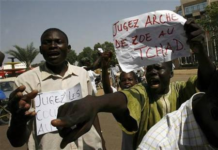 Hundreds of students protest in the streets of N'Djamena November 10, 2007 to demand that seven Europeans freed at the weekend return to face trial over an attempt to fly 103 African children to live in Europe. The banner reads ''Judge Zoe Ark in Chad''. REUTERS /Luc Gnago