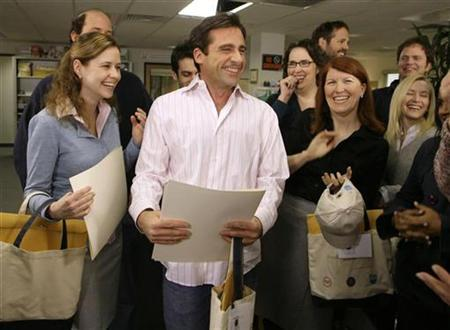 Steve Carell (C) laughs along with other members of ''The Office'' cast including Jenna Fischer (L), Phyllis Smith, (2rd R, in glasses) and Kate Flannery (2nd R) on the set in Panorama City, California, January 11, 2007. REUTERS/Danny Moloshok