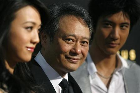 Director of the film, Ang Lee (C) poses with cast members Tang Wei (L) and Wang Leehom at the premiere of ''Lust, Caution'' at the Academy of Motion Picture Arts and Sciences in Beverly Hills, California October 3, 2007. A Chinese anti-virus company has warned against free downloads of ''Lust, Caution'', saying several hundred sites offering the service were embedded with viruses. REUTERS/Mario Anzuoni