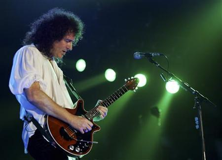 Brian May, member of the band Queen, performs during their ''European Tour 2005'' at the Palau Sant Jordi Stadium in Barcelona in this April 2, 2005 file photo.